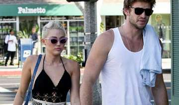 hemsworth s family supports his split from cyrus...