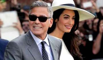 why is george clooney scared of his wife amal...