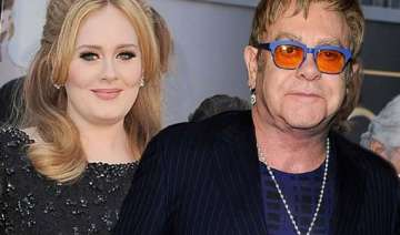 adele apologises to elton john for missing his...
