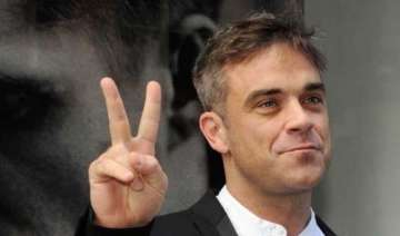 robbie williams plans to quit music for a proper...