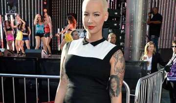 amber rose poses in revealing swimsuit - India TV
