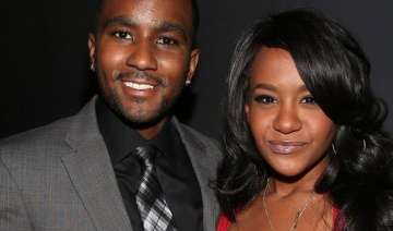 why is nick gordon trying to delay lawsuit in...