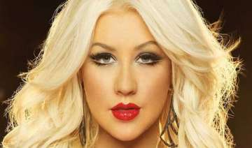christina aguilera poses topless - India TV