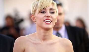 miley cyrus bares nipples at mtv video music...