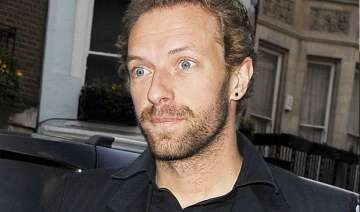did chris martin hit a photographer with jeep -...