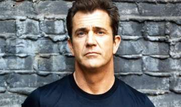 mel gibson accused of attacking photographer in...