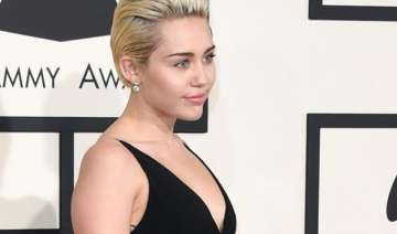 miley cyrus poses topless with pet cat - India TV