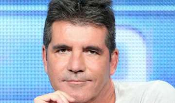 tomlinson cowell trying to form girl band - India...