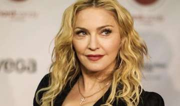madonna accused of using hebdo s name to promote...