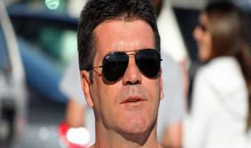 is simon cowell going to be a dad - India TV
