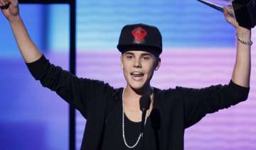 justin bieber apologised to bill clinton report -...