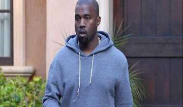 kanye west accused of attacking photographer -...