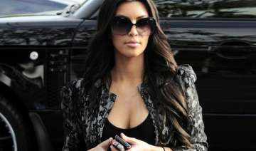 kim kardashian shows off ample cleavage even at...