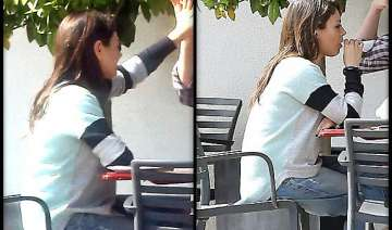 is mila kunis trying to hide baby bump opts for...