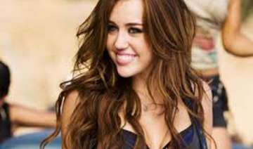 miley cyrus hires fan for assistance - India TV