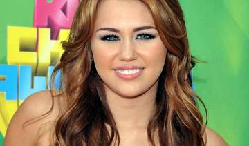 miley cyrus uses supplements for hair growth -...