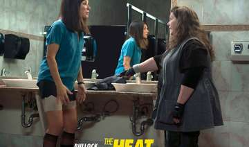 movie review the heat lukewarm frothy potboiler -...