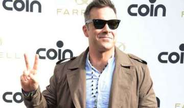 robbie williams buys caribbean holiday home -...