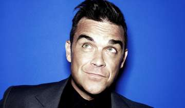 robbie williams follows lengthy beauty regime -...