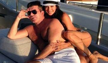 simon cowell to give pregnant lover a mansion -...