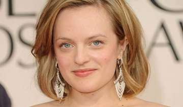 elisabeth moss compares acting with stripping -...