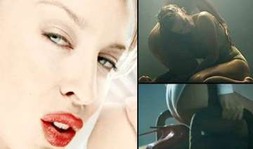 kylie minogue sheds clothes in new raunchy video...