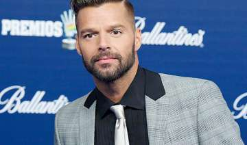 ricky martin takes sons on tour for stability -...