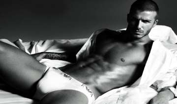 david beckham flaunts toned abs in new ad see...