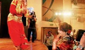 helen touches sudha chandran s feet after...