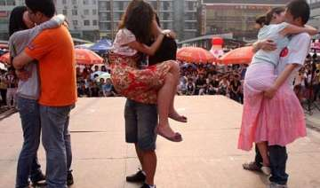 chinese couples in kissing competition prize rs...