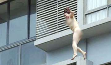 chinese woman jumps naked from 11th floor...