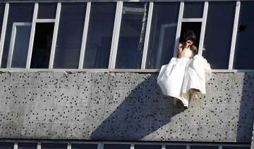 jilted bride in china tries to leap from seventh...