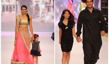 television stars with their kids walk the ramp...