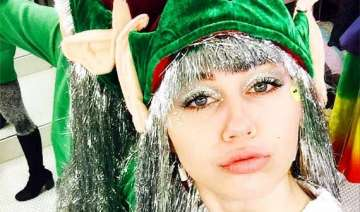 miley cyrus gears up for christmas with full elf...
