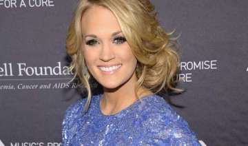 carrie underwood never steps out without make up...