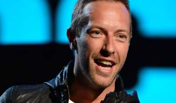 coldplay frontman chris martin caught up in love...