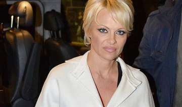 pamela anderson doesn t feel pretty enough to...