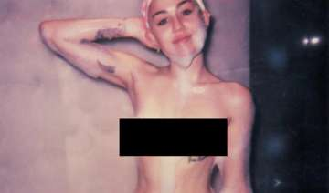 miley cyrus bares all in magazine photoshoot -...