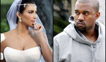kanye won t let fiance kim wear vera wang gown...