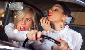 most women do up face while driving - India TV