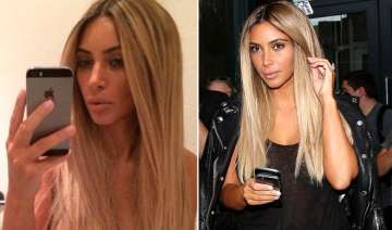 omg kim kardashian goes back to her blonde days...
