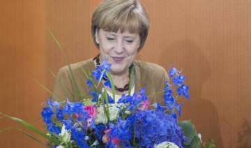 amid looming polls merkel gets flap over us...