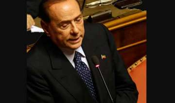 berlusconi defeated decides to back italy...