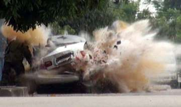 bomb squad officer narrowly escapes explosion in...