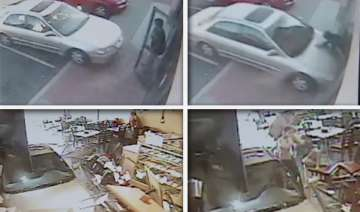 cctv footage of car crashing in restaurant -...