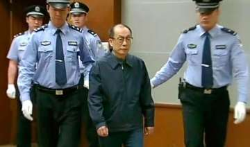 china probes 32 minister level officials for...