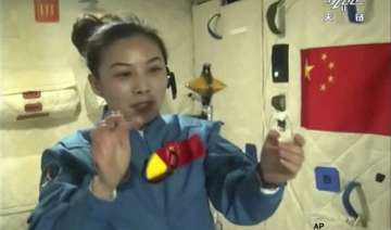 chinese astronauts give lecture to kids from...