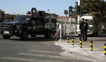 chinese police seek 8 following tiananmen attack...