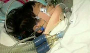 chinese girl who fell 10 storeys wakes up from...