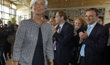 christine lagarde takes over as new imf chief -...